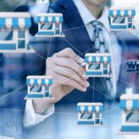 Businessman draws franchise marketing system .
